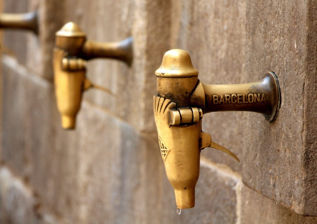metal taps on stone wall
