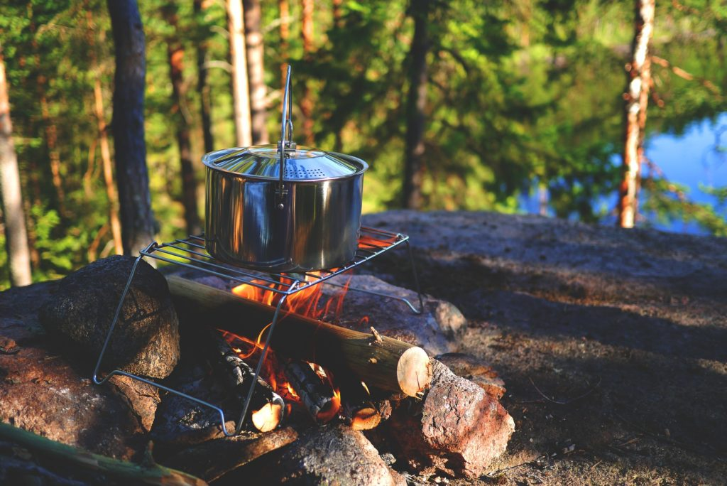 cooking pot on campfire in forest