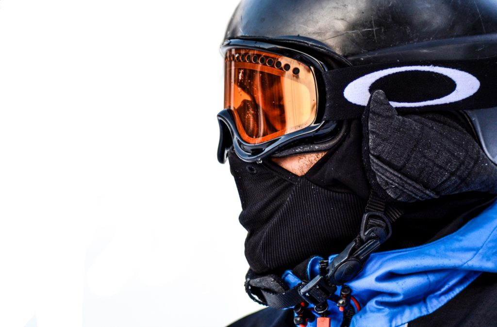 man wearing helmet and ski mask