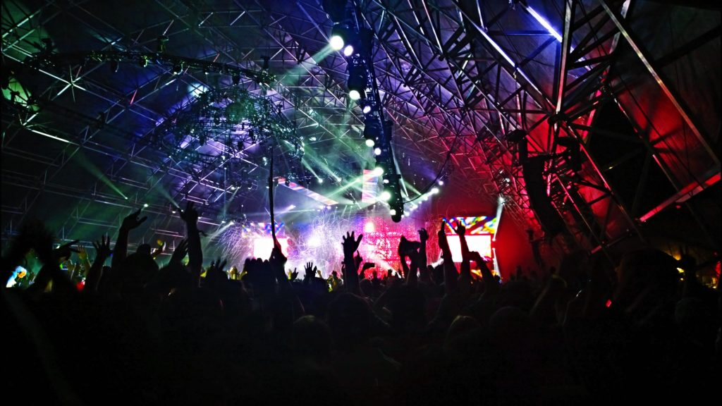 concert with crowd, scaffolding and lights