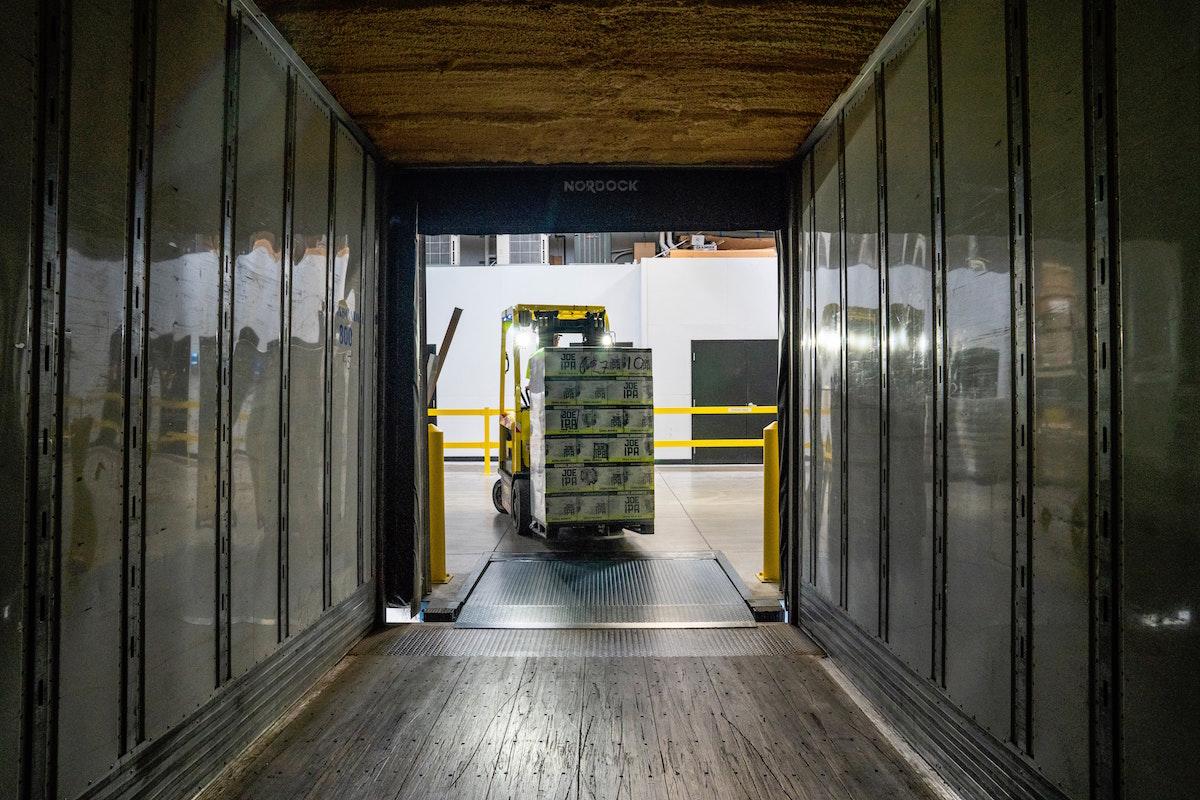 haulage forklift delivering into a truck