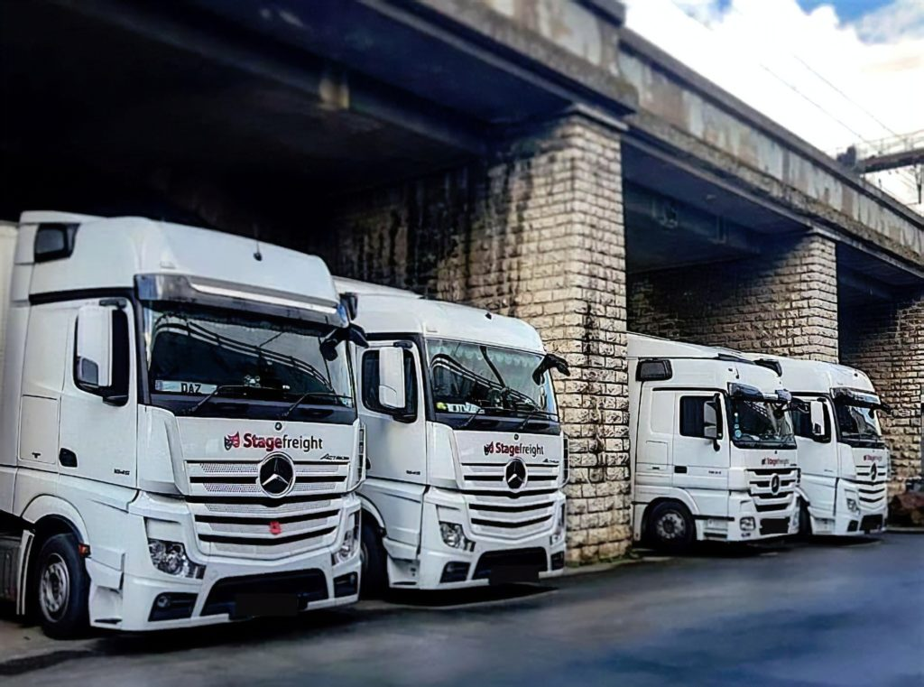 row of trucks under bridge