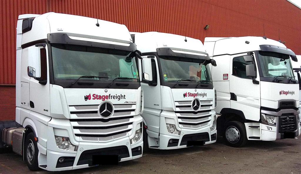 three trucks parked outside Stagefreight