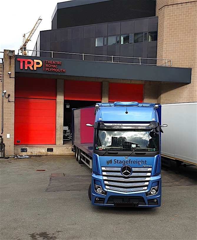 blue truck outside theatre